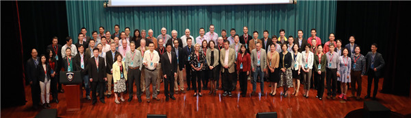 Academics pose for a group photo.jpg