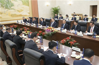 Wang Yang meets guests of DPRK, Vietnam, Laos