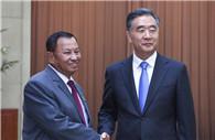 Wang Yang meets senior Cambodian politician