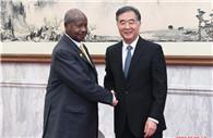 Wang Yang meets Ugandan president
