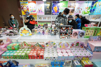 Toy show attendees try their luck with blind boxes