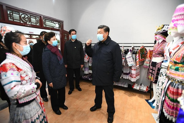Xi gives Miao embroidery thumbs up while visiting SW China village