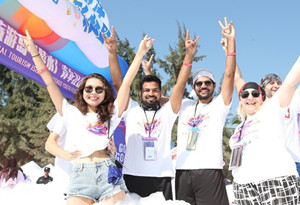 Global youth gather in Lingshui for water sports, music festival