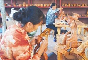 Li pottery making skills fire up in Sanya