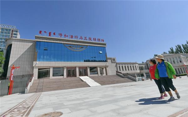 Residents walk past the Hohhot Ulan Muqir at Jinqiao Economic Development Zone, southeast of the city, Inner Mongolia autonomous region on July 5..jpg