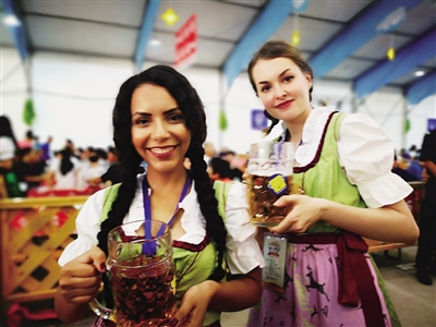 Two German waitresses pose for a photograph at the opening ceremony of Oktoberfest in Hohhot, Inner Mongolia autonomous region, July 7.jpg