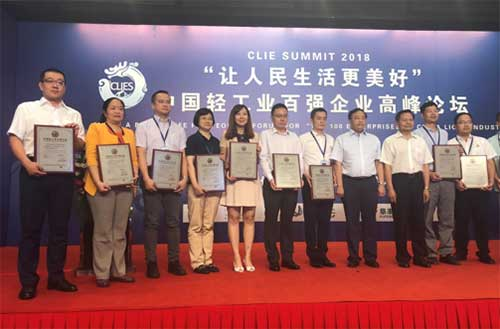 Luo Yan (1st from left), vice-president of Yili Group, joins representatives of awarded enterprises onstage at the Forum for Top 100 Enterprises in China Light Industry in Beijing June 20.jpg
