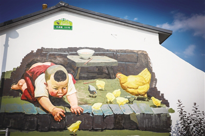 A child reaches out for a chick is painted on the wall of Yematu village, Hohhot, Inner Mongolia.png
