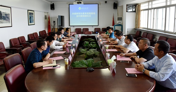 A signing ceremony between Inner Mongolia Normal University (IMNU) and seven Xiliin Gol League high schools is held at the university on June 25..jpg