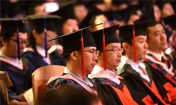 Graduates attend the ceremony held at Saihan campus of IMNU, July 3..jpg