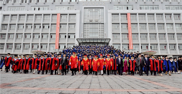Graduates and staff pose for a photograph after the graduation ceremony held at IMNU on July 3..jpg