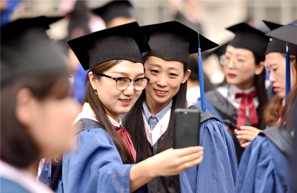 Graduates take a selfie to mark their graduation from IMNU, July 3..jpg