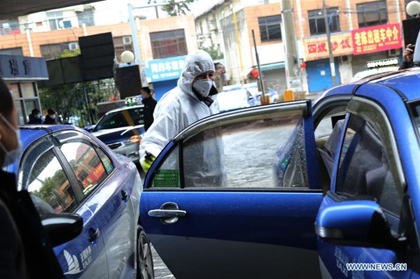 A worker disinfects a taxi at a service point in Wuxi, East China's Jiangsu province, Jan 26, 2020.jpg