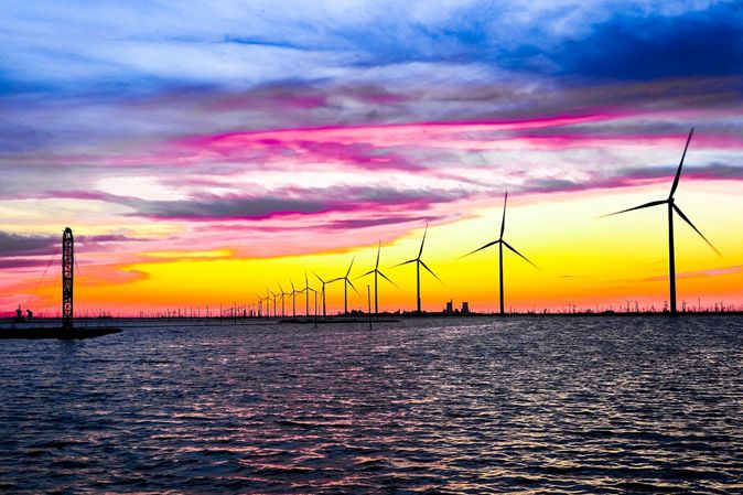 Wind turbines installed along Bohai Bay in Shandong