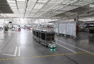 Automated vehicles transport giant components at car plant in Tianjin, China